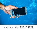 waterproof phone underwater in... | Shutterstock . vector #718185997