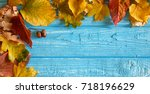 autumn leaves and acorns over... | Shutterstock . vector #718196629
