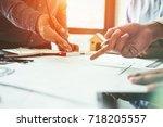 consultation between colleagues ... | Shutterstock . vector #718205557