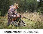 hunter with a backpack and a...   Shutterstock . vector #718208761