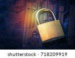 padlock on computer motherboard.... | Shutterstock . vector #718209919