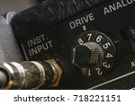 guitar cable in the jack of the ... | Shutterstock . vector #718221151
