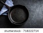 cast iron pan on rustic black... | Shutterstock . vector #718222714