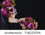 Stock photo portrait of a girl with sugar skull makeup over black background calavera catrina dia de los 718225354