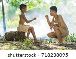 two little boys sitting on a... | Shutterstock . vector #718238095