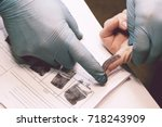 the investigator takes... | Shutterstock . vector #718243909