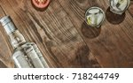 vodka and snack on the table.... | Shutterstock . vector #718244749