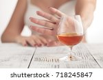 woman refused a glass of wiskey | Shutterstock . vector #718245847