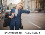 oung stylish businesswoman with ... | Shutterstock . vector #718246075