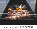 shish kebab on the grill is... | Shutterstock . vector #718247239