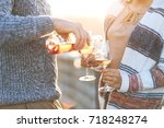 Stock photo man and woman with glass of rose wine on summer beach picnic 718248274