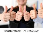 Small photo of Group of people show OK or confirm with thumb up during conference closeup. High level quality product, serious offer, mediation solution, happy client, creative advisor participation concept