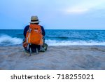 traveler with backpack and...   Shutterstock . vector #718255021