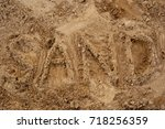 inscription on the sand   Shutterstock . vector #718256359