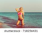 woman relaxing on the beach   Shutterstock . vector #718256431