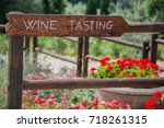 wooden wine tasting sign in the ...   Shutterstock . vector #718261315