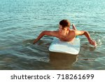 surfer with board   Shutterstock . vector #718261699