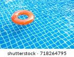orange pool float  ring... | Shutterstock . vector #718264795