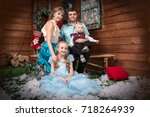 family in the room decorated... | Shutterstock . vector #718264939