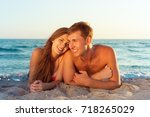 happy family on the beach | Shutterstock . vector #718265029