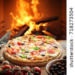 ready pizza on a wooden table.... | Shutterstock . vector #718273504