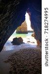 beach acces through mountain    Shutterstock . vector #718274995