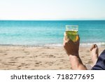 man relaxing on a beach with...   Shutterstock . vector #718277695
