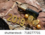 champagne on a stony beach by...   Shutterstock . vector #718277731