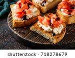 bruschetta with tomatoes ... | Shutterstock . vector #718278679