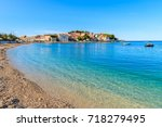 pebble stone beach with crystal ...   Shutterstock . vector #718279495