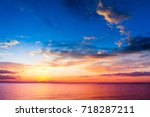 setting into the sea burning... | Shutterstock . vector #718287211