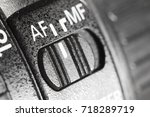 Small photo of Lens autofocus button, close-up, selective focus with shallow depth of field.