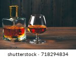 glass of brandy or cognac and... | Shutterstock . vector #718294834