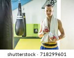 young kick box fighter with... | Shutterstock . vector #718299601