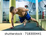 young handsome man doing push... | Shutterstock . vector #718300441