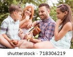 family playing guitar in their... | Shutterstock . vector #718306219