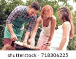young family having barbecue... | Shutterstock . vector #718306225