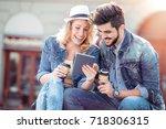 portrait of attractive couple... | Shutterstock . vector #718306315