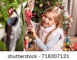 joyful female kid preparing... | Shutterstock . vector #718307131