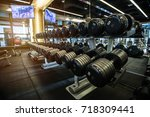 rows of dumbbells and fitness... | Shutterstock . vector #718309441