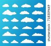 set of white clouds on a blue... | Shutterstock .eps vector #718309669