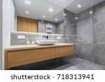 modern bathroom with wooden... | Shutterstock . vector #718313941