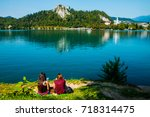 girls reading books by the lake ... | Shutterstock . vector #718314475