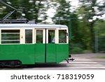 green historic tram in motion.... | Shutterstock . vector #718319059