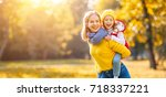 happy family mother and child... | Shutterstock . vector #718337221