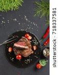 rare rib eye steak on dark... | Shutterstock . vector #718337581