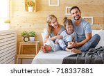 happy family mother  father and ... | Shutterstock . vector #718337881
