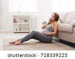 pregnant woman listening to... | Shutterstock . vector #718339225