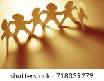 team of paper chain people | Shutterstock . vector #718339279
