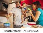 lovely family in kitchen... | Shutterstock . vector #718340965